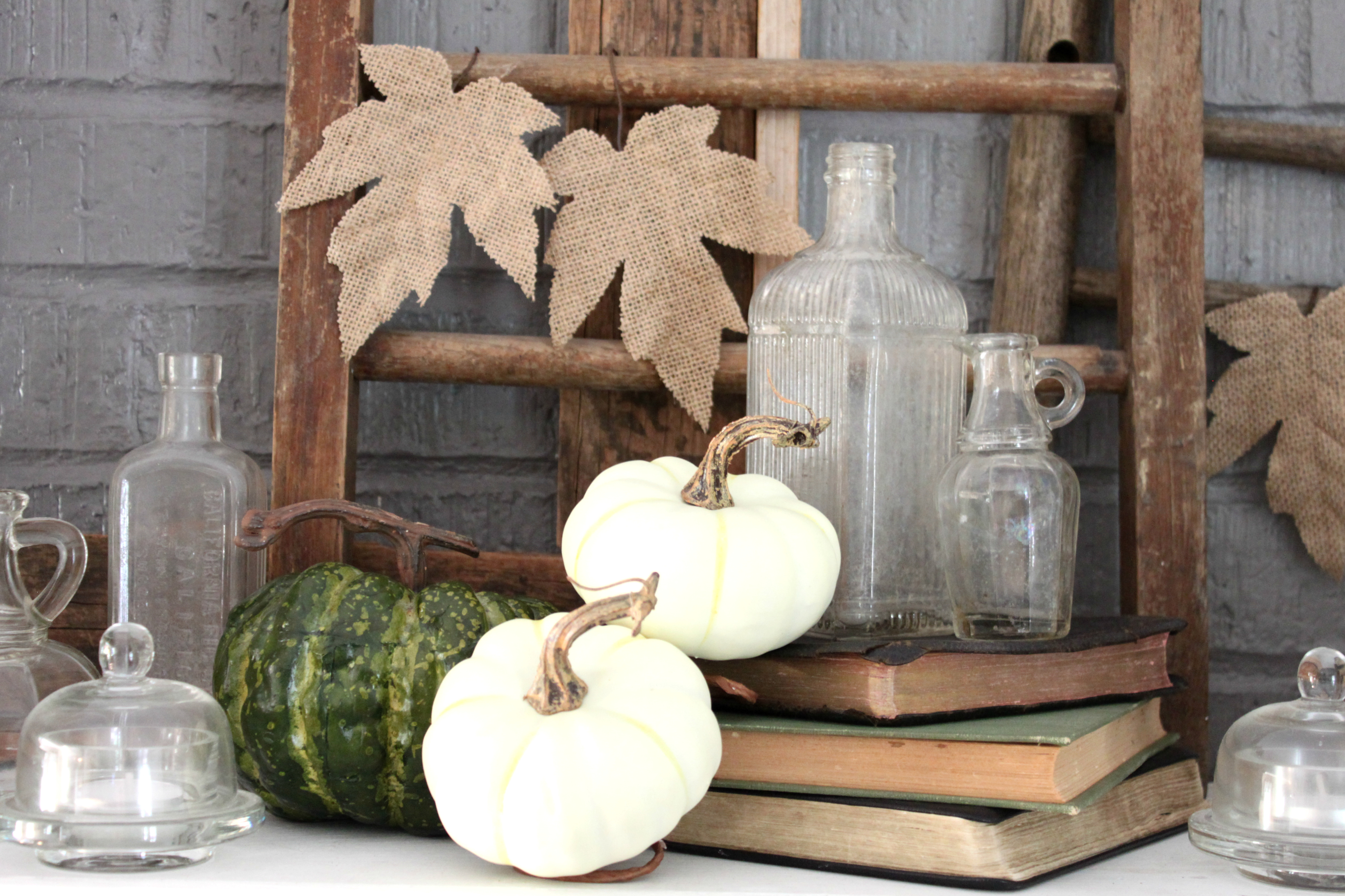 fall-dining-room-books-medicine-bottles-pumpkins