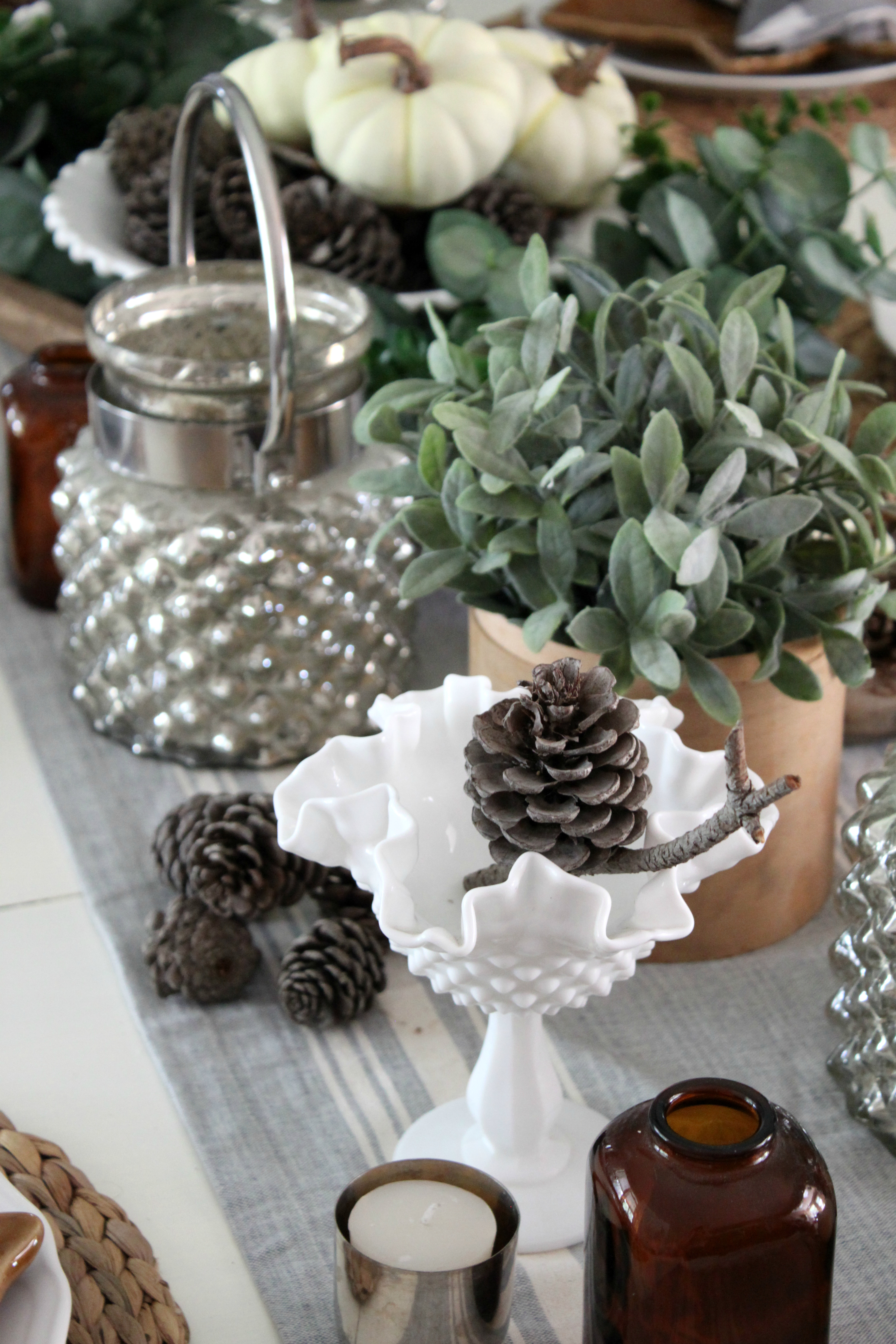 fall-dining-room-tablescape-milkglass-pinecones
